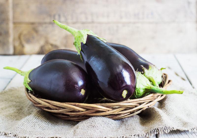 Organic Eggplants and Basket